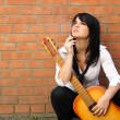 Woman with a cigarette and a guitar — Stock Photo #1033613
