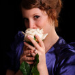 Nice woman with a rose — Stock Photo #3309760
