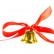 Stock Photo: Shiny golden Christmas bell decorated with red bow - isolated on white background