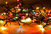 Christmas lights on dark background — Stock Photo
