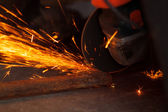 Cutting metal with many sharp sparks — Stock Photo