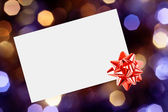 Christmas card with bow — Stock Photo