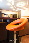 Orange and leather stools — Стоковое фото