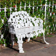 White wrought iron bench — Stock Photo