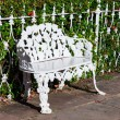 Stock Photo: White wrought iron bench