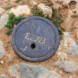 Manhole cover — Stockfoto