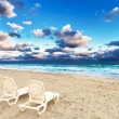 Deckchairs on a beach — Stock Photo