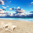 Deckchairs on beach — Stock Photo #30387007