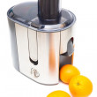 Juicer and oranges — Stock Photo