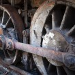 Rusty wheels of old steam locomotive — Stock Photo