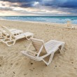 Deckchairs on beach — Stok fotoğraf