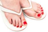 Female feet in sandals — Stock Photo