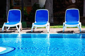 Chairs by the pool — Стоковое фото