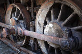 Rusty wheels of old steam locomotive — Stok fotoğraf