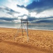 Chair on an empty beach — Stock Photo #36549483