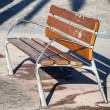 Bench in the alley — Stock Photo