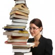 Girl holding a very large pile of books — Stock Photo #2259247