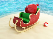 Sleigh of Santa Claus on the beach — Stock Photo