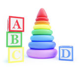 Pyramid toy and alphabet blocks — Stock Photo