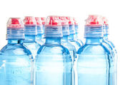 Plastic bottle of drinking water isolated on white — Stock Photo