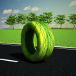 Green wheel on the road — Stock Photo