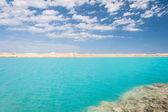 Amazing Blue lake among the sand and rocks — Stock Photo