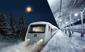 Night scene with train at the station in winter — Stock Photo