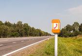 SOS Phone on the road — Zdjęcie stockowe
