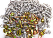 Background from many steel screws with a drill tip — Stock Photo