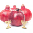 Two golden Menorah with pomegranates — Stock Photo