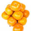 Big heap of persimmons — Stock Photo