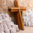 Stock Photo: Wooden crosses and bugs leaning the wall