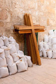 Wooden crosses and bugs leaning the wall — Stock Photo