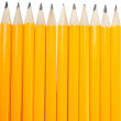 Group of eleven vertical new yellows pencils — Stock Photo