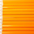Group of eleven horizontal new yellows pencils — Stock Photo