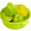 Some green peppers in a light green bowl — Stock Photo