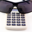 Calculator & Sunglasses — Stock Photo