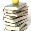 Books stack with apple — Stockfoto