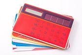 Red calculator and plastic cards — Foto de Stock