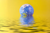 Globe on water — Foto Stock