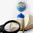 Dictionary and globe — Stock Photo