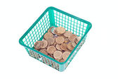 Small israeli coins in green basket — Stock Photo