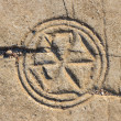 Ancient symbol on the floor of the ruined synagogue — Stock Photo #38472161