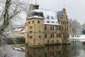 Castle on water in Dortmund covered with snow — Stock Photo