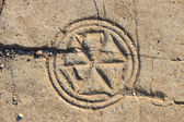 Ancient symbol on the floor of the ruined synagogue — Photo