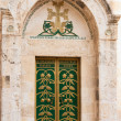 Green door in courtyard Holy Sepulcher — Stock Photo