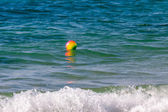 Bright colorful ball on waves in Mediterranean Sea — Stockfoto