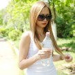 Beautiful woman drinking water at summer green park. — Stock Photo #12448026