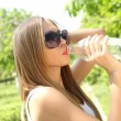 Profile of beautiful woman drink some water from plastic bottle — Foto Stock