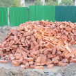 Lots red clay bricks lying - Stock Photo